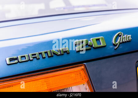 Rear badge of a blue Ford Cortina Mark V 2.0 Ghia (1979-1982) - Stock Photo