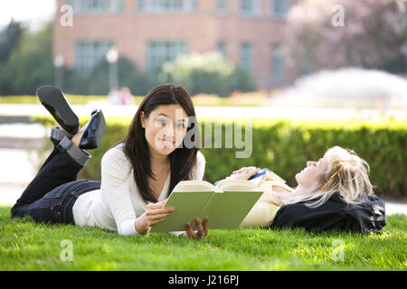 A shot of two college students studying on campus - Stock Photo