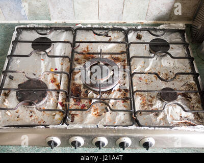 The Full Display of A Dirty Gas Metal Top Hob with Several Plates and Dials Turned off, in An Unclean and Dirty - Stock Photo