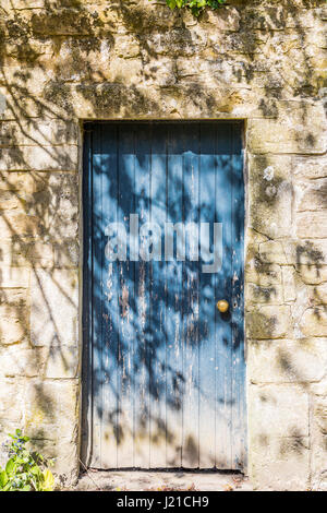 an old blue door in a stone wall in Bath England, UK - Stock Photo