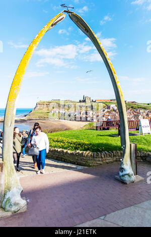WHITBY Abbey NORTH YORKSHIRE UK St Mary's Parish Church and Whitby Abbey ruins viewed through two arched whale bones - Stock Photo