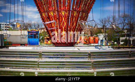 View on carousel seats, during spring sunny day. - Stock Photo