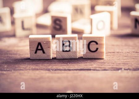 wooden elements with the letters collected in the word abc - Stock Photo