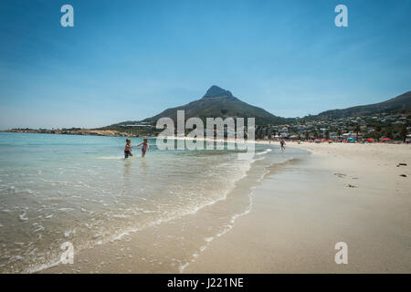 KIDS PLAYING IN THE OCEAN, CAMPS BAY BEACH - Stock Photo