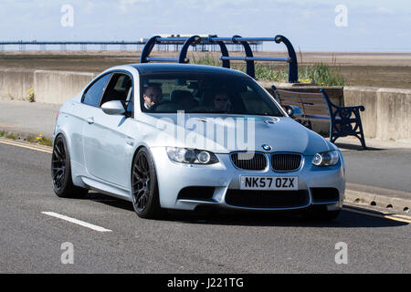 BMW M3 330i V6 Vintage Festival and Classic Sport Vehicle Show, with cars driving down the resort seafront and promenade, - Stock Photo