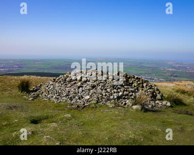 The large Cairn at the summit of Dent Fell, the first fell on the coast to coast walking route, Cumbria, Uk - Stock Photo