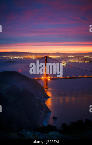 View of Golden Gate Bridge from Hawk Hill at Sunrise with Dramatic Clouds - Stock Photo