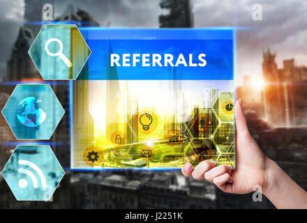 Technology, internet, business and marketing. Young business woman writing word: Referrals - Stock Photo