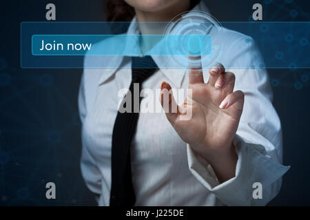 Business, technology, internet and networking concept. Business woman presses a button on the virtual screen: Join - Stock Photo