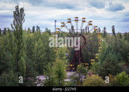 Aerial view with ferris wheel in amusement park of Pripyat ghost city, Chernobyl Nuclear Power Plant Zone of Alienation - Stock Photo