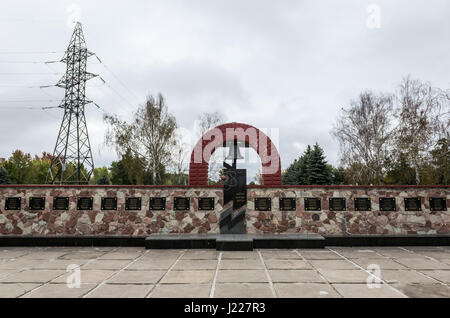 Memory wall with names of victms of Chernobyl disaster in front of Chernobyl Nuclear Power Plant in Zone of Alienation, - Stock Photo