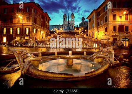Spanish Steps and Fontana della Barcaccia in Rome at early morning, Italy - Stock Photo