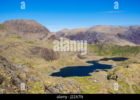 High view to Llyn Llydaw lake from slopes of Y Lliwedd in Snowdon Horseshoe with hikers in mountains of Snowdonia National Park. Gwynedd, Wales, UK