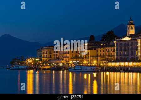 Bellagio village at dusk at Bellagio, Lake Como, Italy in April - Stock Photo