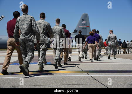 Air Force ROTC cadets walk toward a C-130J Hercules for an incentive flight during Pathways to Blue April 7, 2017, - Stock Photo