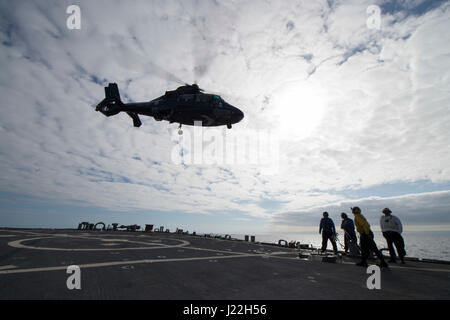 170417-N-ZE250-394   ATLANTIC OCEAN (April 17, 2017) - A Royal Navy HH-65 Dauphin helicopter takes off from USS - Stock Photo