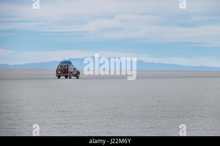 Off-road vehicle in Salar de Uyuni salt flat - Potosi Department, Bolivia - Stock Photo
