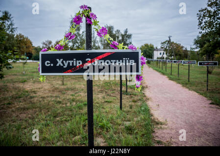Alley with a signs of displaced villages in Chernobyl town, Chernobyl Nuclear Power Plant Zone of Alienation around - Stock Photo