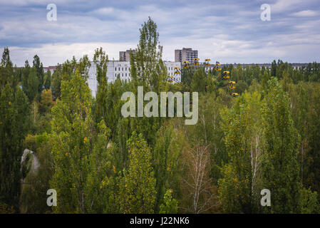 Aerial view from Polissya Hotel with ferris wheel in Pripyat ghost city of Chernobyl Nuclear Power Plant Zone of - Stock Photo