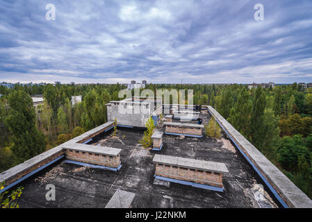 View from roof of Polissya Hotel in Pripyat ghost city of Chernobyl Nuclear Power Plant Zone of Alienation around - Stock Photo