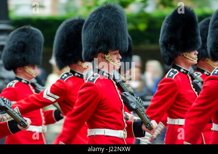 LONDON - JUNE 13, 2015: Members of the Queen's Royal Guard march on The Mall in a ceremony for Her Majesty's birthday - Stock Photo