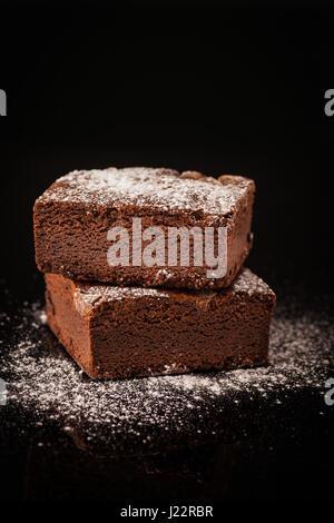 Chocolate Brownie on black background - Stock Photo