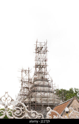 The old pagoda under renovation isolated on white  background. - Stock Photo