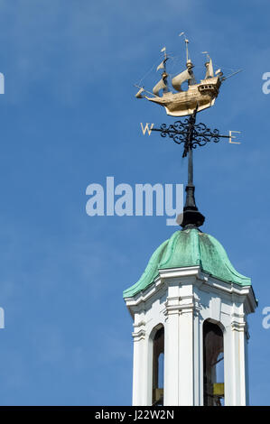 ornate weather vane on top of a bell tower - Stock Photo