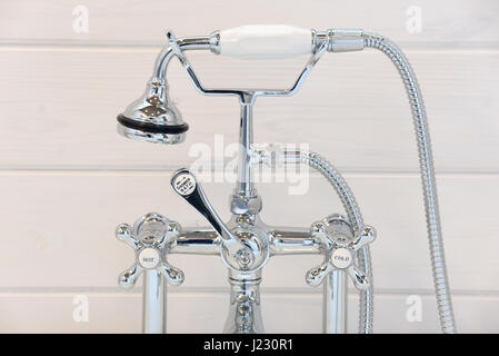 Vintage bathtub faucet and shower head. - Stock Photo