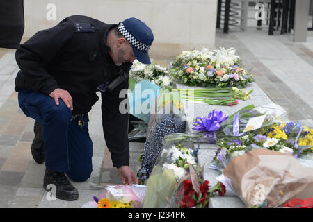 Floral tributes for PC Keith Palmer who was killed on 21st March in a terrorist attack, are placed outside New Scotland - Stock Photo