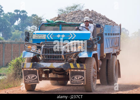 KRONG, CAMBODIA - JANUARY 07 2015 :  truck with an open cockpit working on the construction of the road . Cambodia - Stock Photo