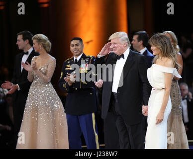 U.S. President Donald Trump salutes soldiers during the Salute to Our Armed Services Ball at the National Building - Stock Photo