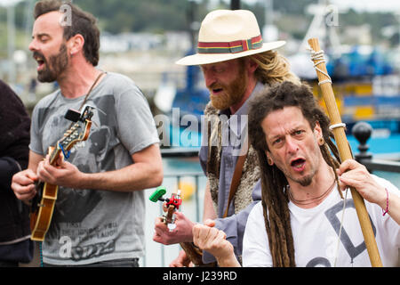 PADSTOW, CORNWALL, UK - APRIL 16, 2017. Members of the political activist musical group Phat Bollard busking in - Stock Photo