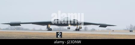 A U.S. Air Force B-2 Spirit stealth bomber aircraft lands on the flight line at the Whiteman Air Force Base January - Stock Photo