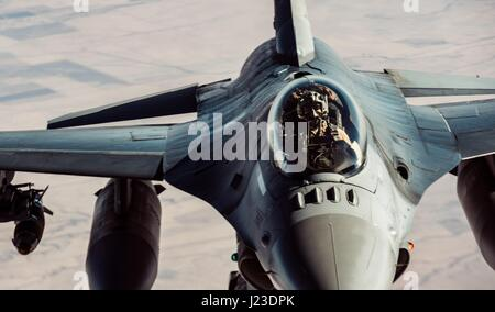 A U.S. Air Force F-16 Fighting Falcon fighter aircraft prepares to refuel in flight January 18, 2017 over Iraq. - Stock Photo