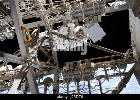 NASA Expedition 50 prime crew astronaut American Peggy Whitson works on the International Space Station during a - Stock Photo
