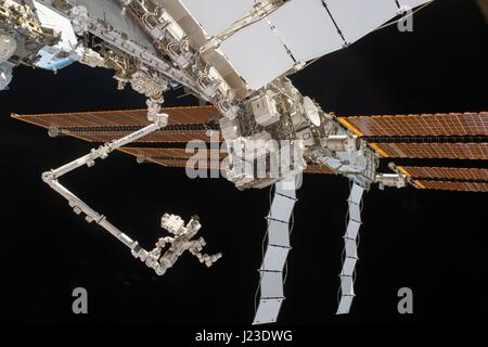 NASA Expedition 50 astronauts capture a view of the Dexter robot attached to the end of the International Space - Stock Photo