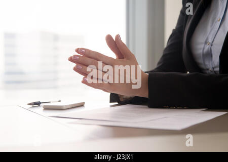Close up of female hands put together, concentration or nerves - Stock Photo