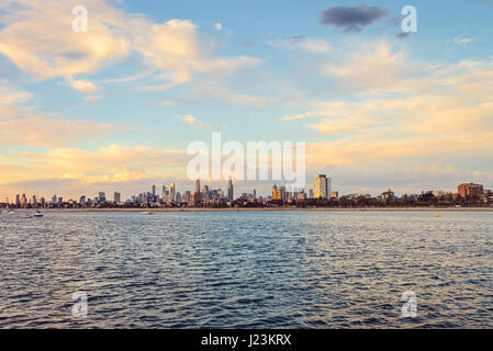 Melbourne city skyline viewed from St. Kilda beach - Stock Photo