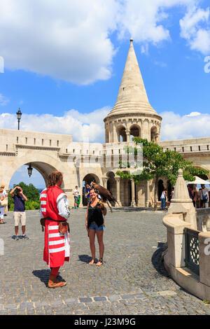 BUDAPEST, HUNGARY - July 24, 2014: Tourists on the Trinity Square near Fisherman's Bastion in Budapest, Hungary - Stock Photo