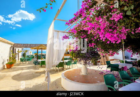 Courtyard of coastal cafe in Torremolinos. Malaga province, Costa del Sol. Andalusia, Spain - Stock Photo