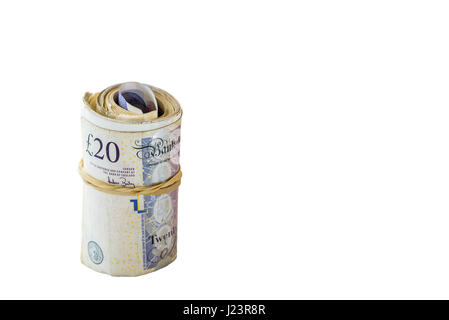 Roll or bundle of cash.Stass of twenty pound notes. - Stock Photo