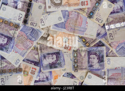 Ten and twenty pound notes, from overhead.Banknotes shot from obove. - Stock Photo