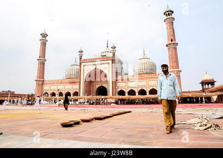 Delhi, India, september 3, 2010: Muslim men walking on in front of mosque Masjid in Delhi, India. - Stock Photo