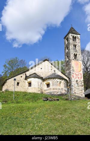Leontica, Switzerland - 17 April 2017:  The Romanesque church of San Carlo di Negrentino in Leontica on  canton - Stock Photo
