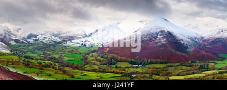 Panoramic view of Newlands Valley from Cat Bells with a snow capped Causey Pike and Derwent Fells beyond. Lake District - Stock Photo