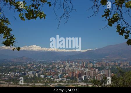 View of the Santiago, capital of Chile, from Cerro San Cristobal. Densely packed modern buildings backed by the - Stock Photo