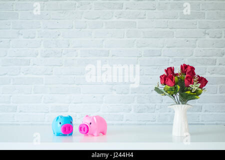 The two piggy bank On a white table For savings - Stock Photo