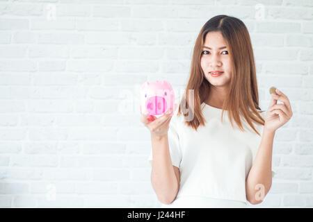 Modern woman feel happy with the savings - Stock Photo