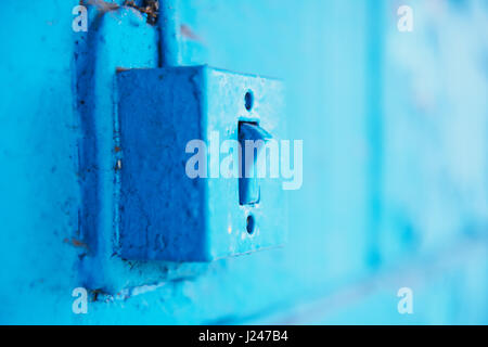 The old switch in the web on the blue brick wall. - Stock Photo